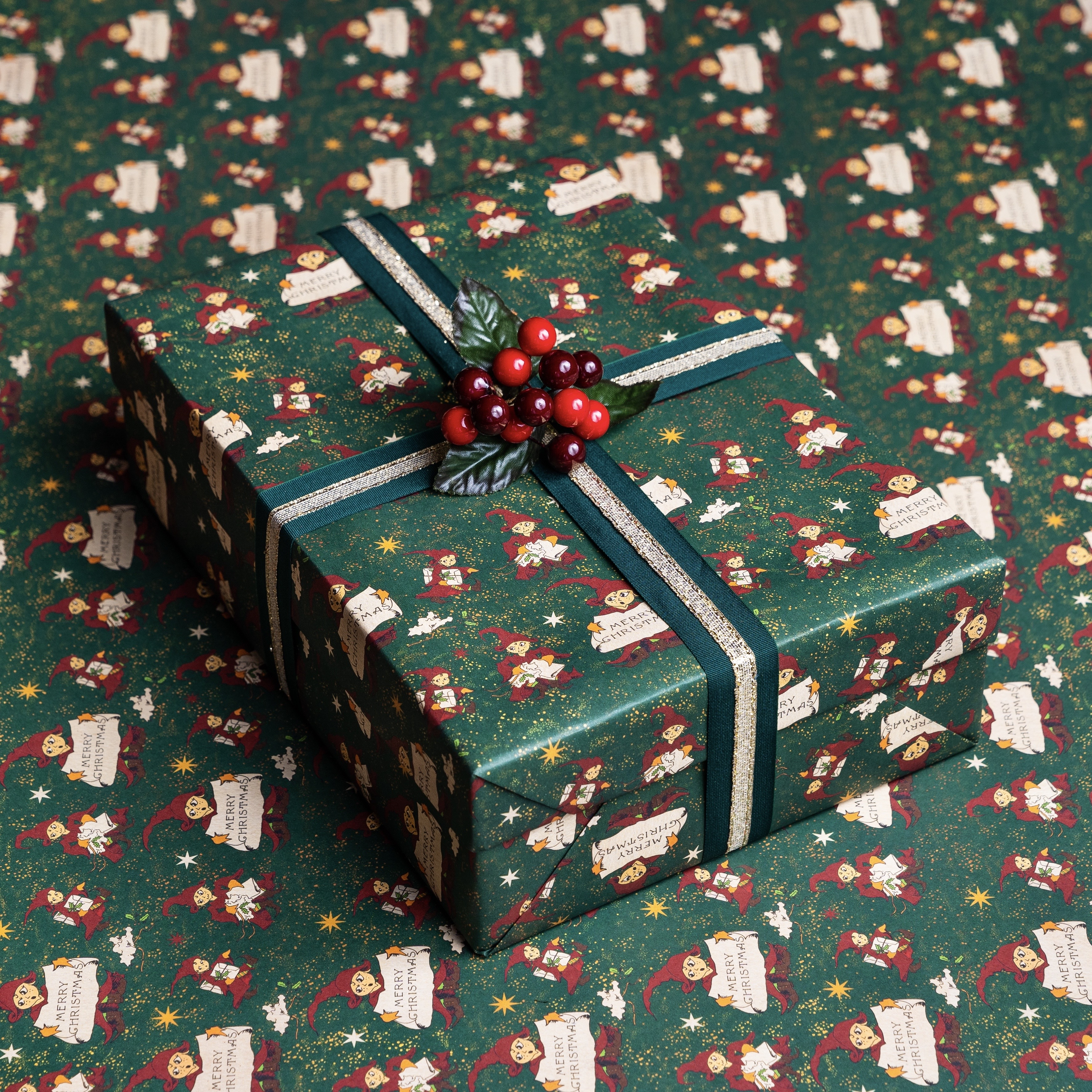 "This Christmas Elf gift wrap is seen briefly in the ""Order of the Phoenix"" film."