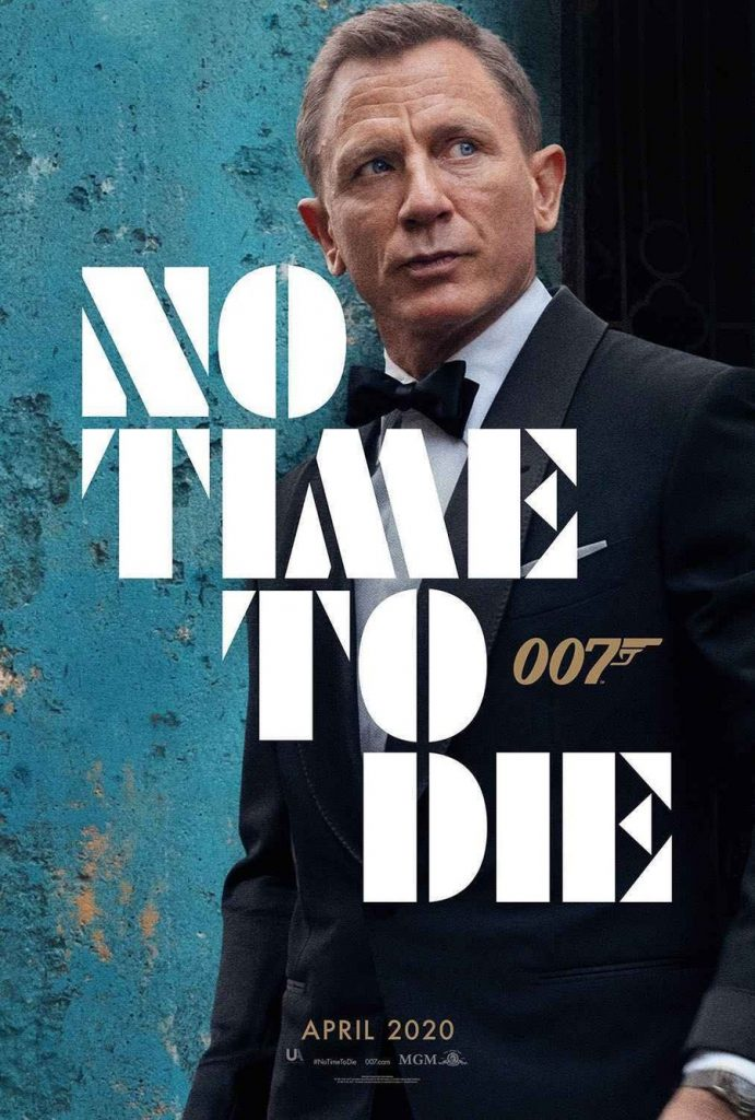"Pictured is a movie poster for ""No Time to Die"", starring Ralph Fiennes."