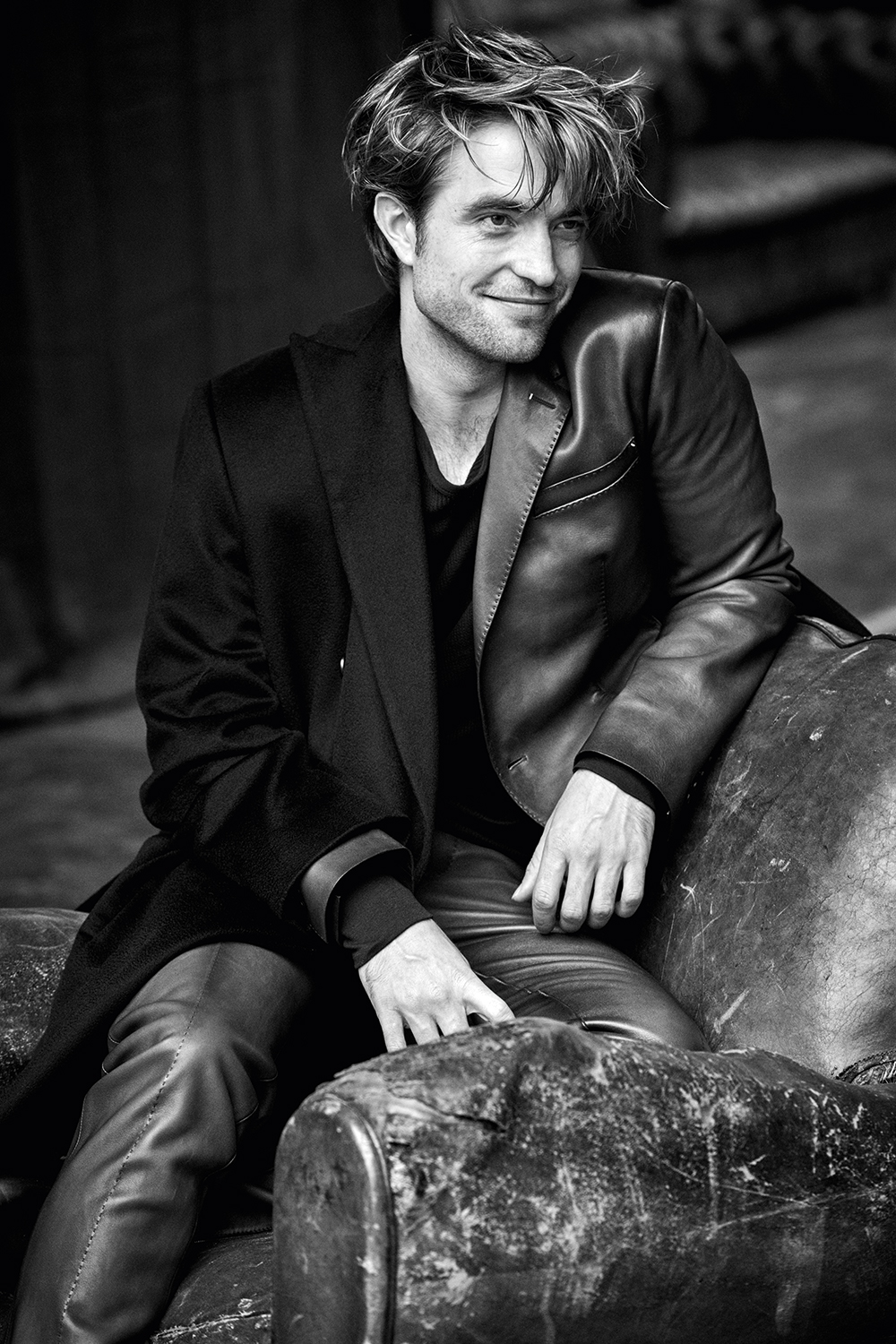 "Robert Pattinson flashes a smile during a photo shoot for ""Variety""."