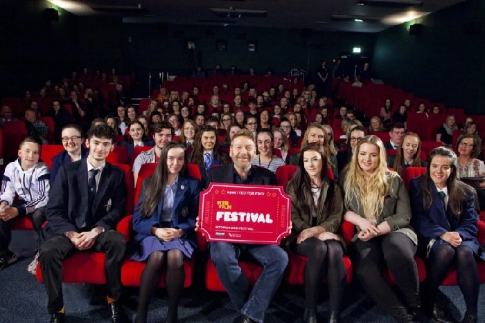 Sir Kenneth Branagh poses with youth attending the Into Film Festival.