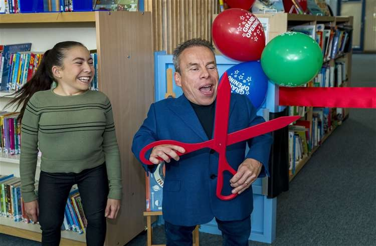 Warwick Davis and daughter Annabelle open a new school extension in Cambridge, England.