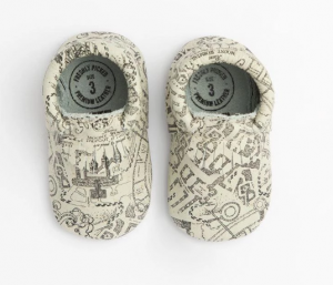 pair of baby shoes printed with marauders map design