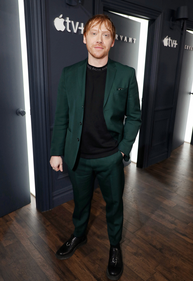 """Rupert Grint looked dashing in an emerald green suit at the """"Servant"""" premiere."""