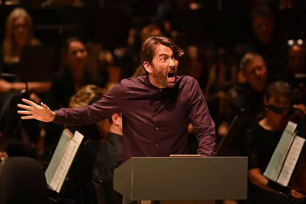 """David Tennant gets animated during a reading from """"Good Omens""""."""