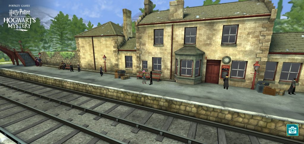 "A screenshot from ""Harry Potter: Hogwarts Mystery"" shows a view of Hogsmeade Station."