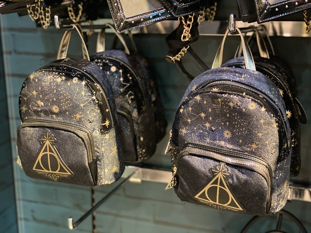 Why have a regular backpack when you can have a Deathly Hallows-themed one?