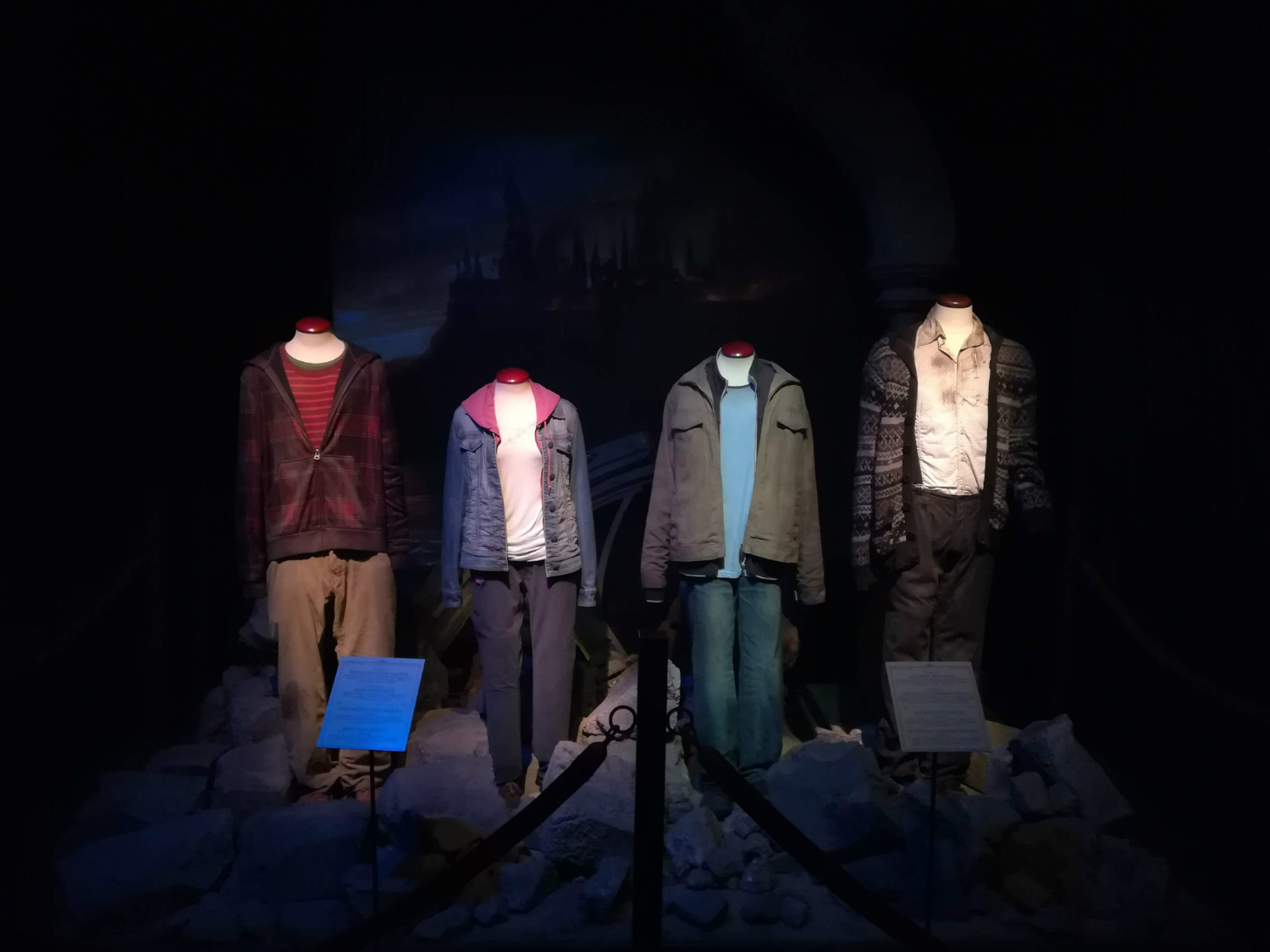 "Ron's, Hermione's, Harry's, and Neville's outfits in ""Harry Potter and the Deathly Hallows"" are on display at ""Harry Potter: The Exhibition"" in Lisbon."