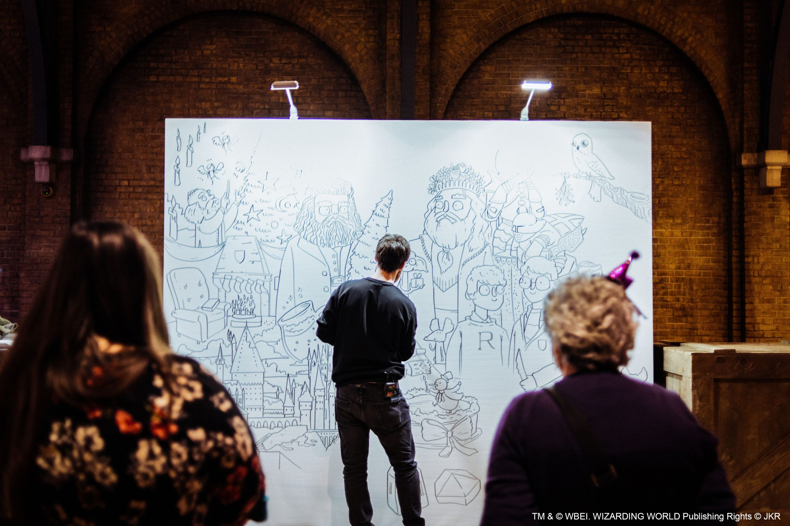 There was also an artist who was creating a mural of Christmas in the wizarding world live at the event.