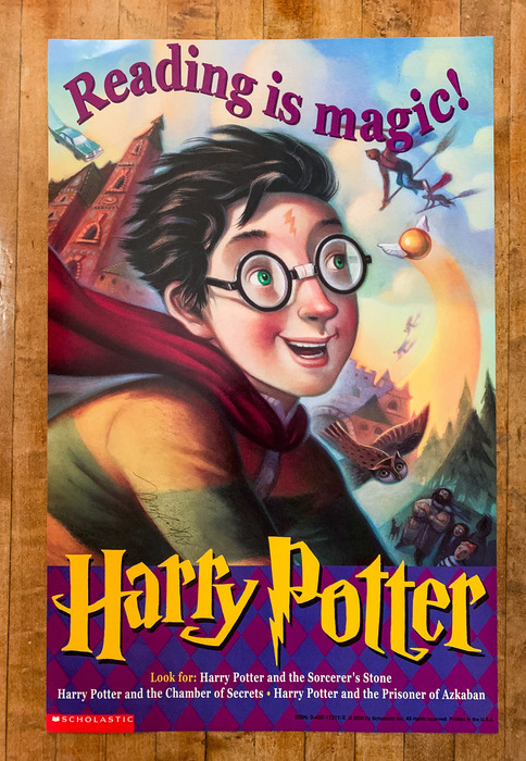 A reading is magic posted signed by Mary GrandPre.