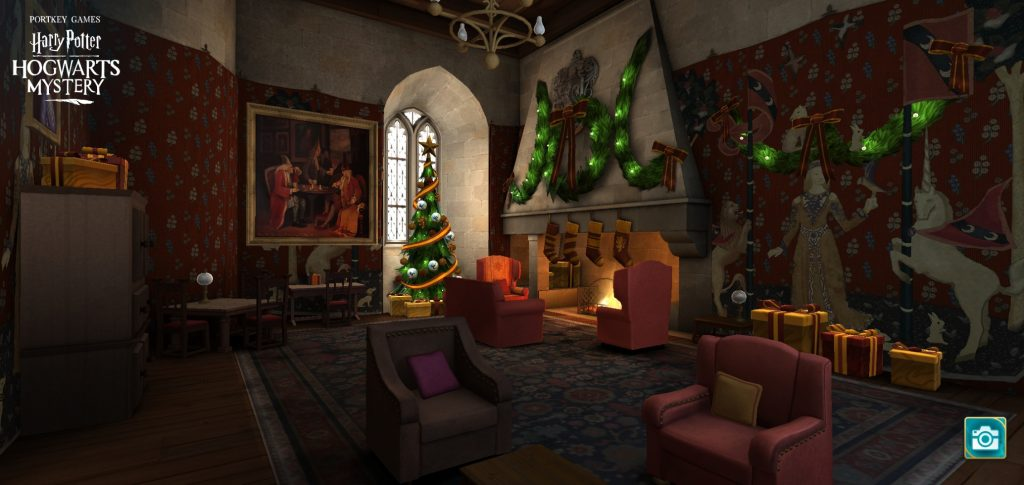 "The Gryffindor Common Room is decorated for Christmas in ""Harry Potter: Hogwarts Mystery""."