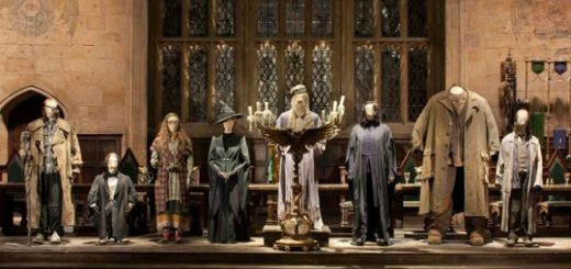 Figures of the Hogwarts staff standing at the front of the Great Hall