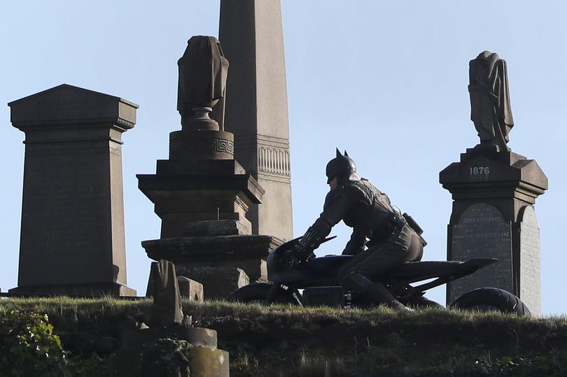 "A stuntman drives through the Glasgow Necropolis during filming for ""The Batman""."
