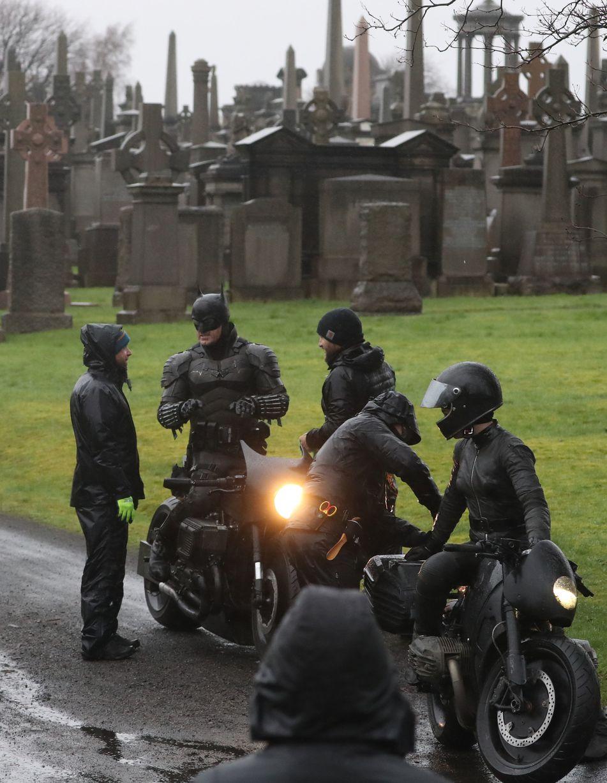"A stuntman on ""The Batman"" takes a break during filming in Glasgow, Scotland."