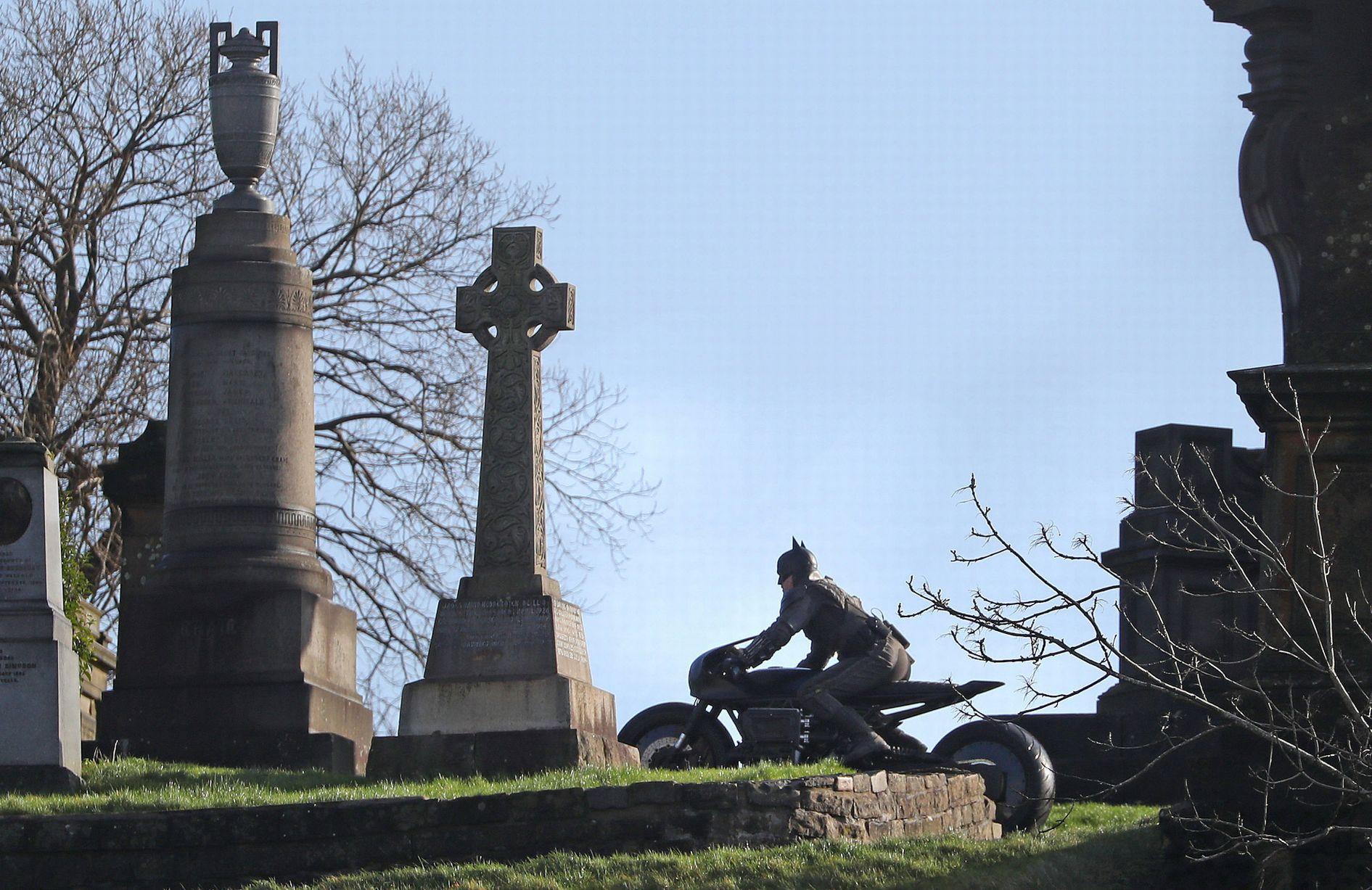 "A stuntman maneuvers around the Glasgow Necropolis during filming for ""The Batman""."