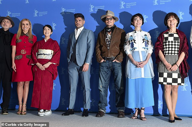 "Johnny Depp poses with some of his ""Minamata"" castmates at the BIFF."