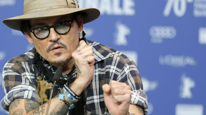 "Johnny Depp describes his feelings about ""Minamata"" during a BIFF press conference."