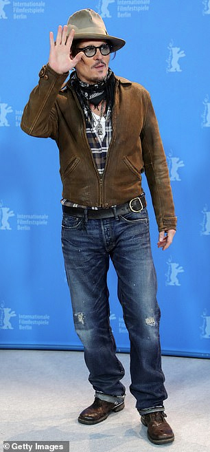 "Johnny Depp waves to the crowd on the not-red carpet during the ""Minamata"" premiere at the BIFF."