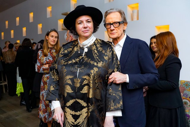 "Bill Nighy poses with Autumn de Wilde at a special screening of ""Emma""."