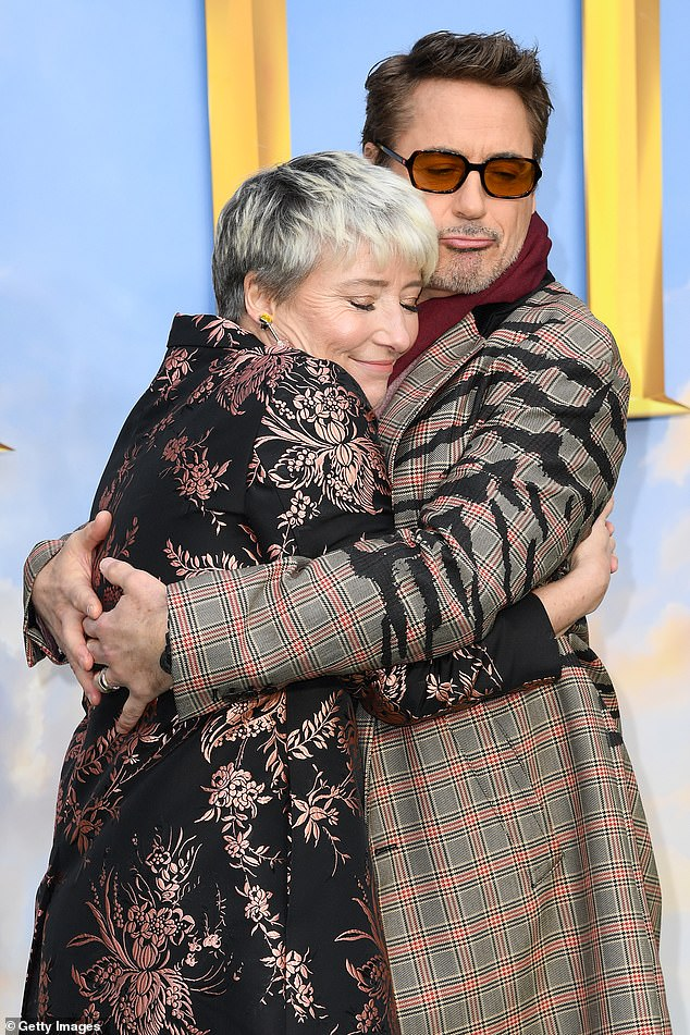 "Dame Emma Thompson hugs Robert Downey Jr. at a ""Dolittle"" screening."