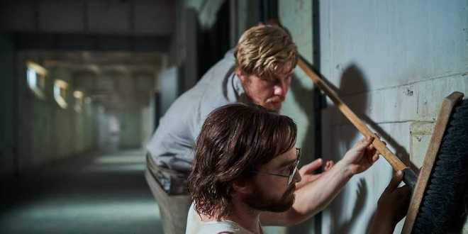 """Daniel Radcliffe and Daniel Webber in a scene from """"Escape from Pretoria""""."""