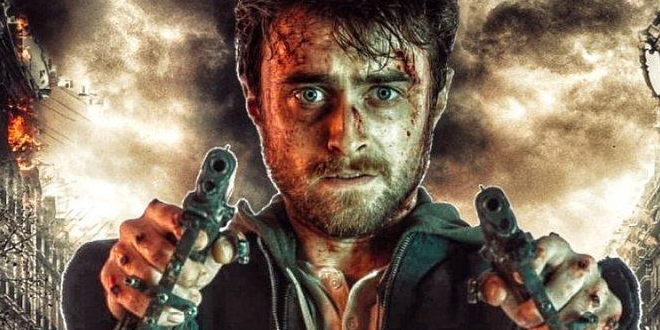Daniel Radcliffe holds two guns at the camera with a stormy background behind him.