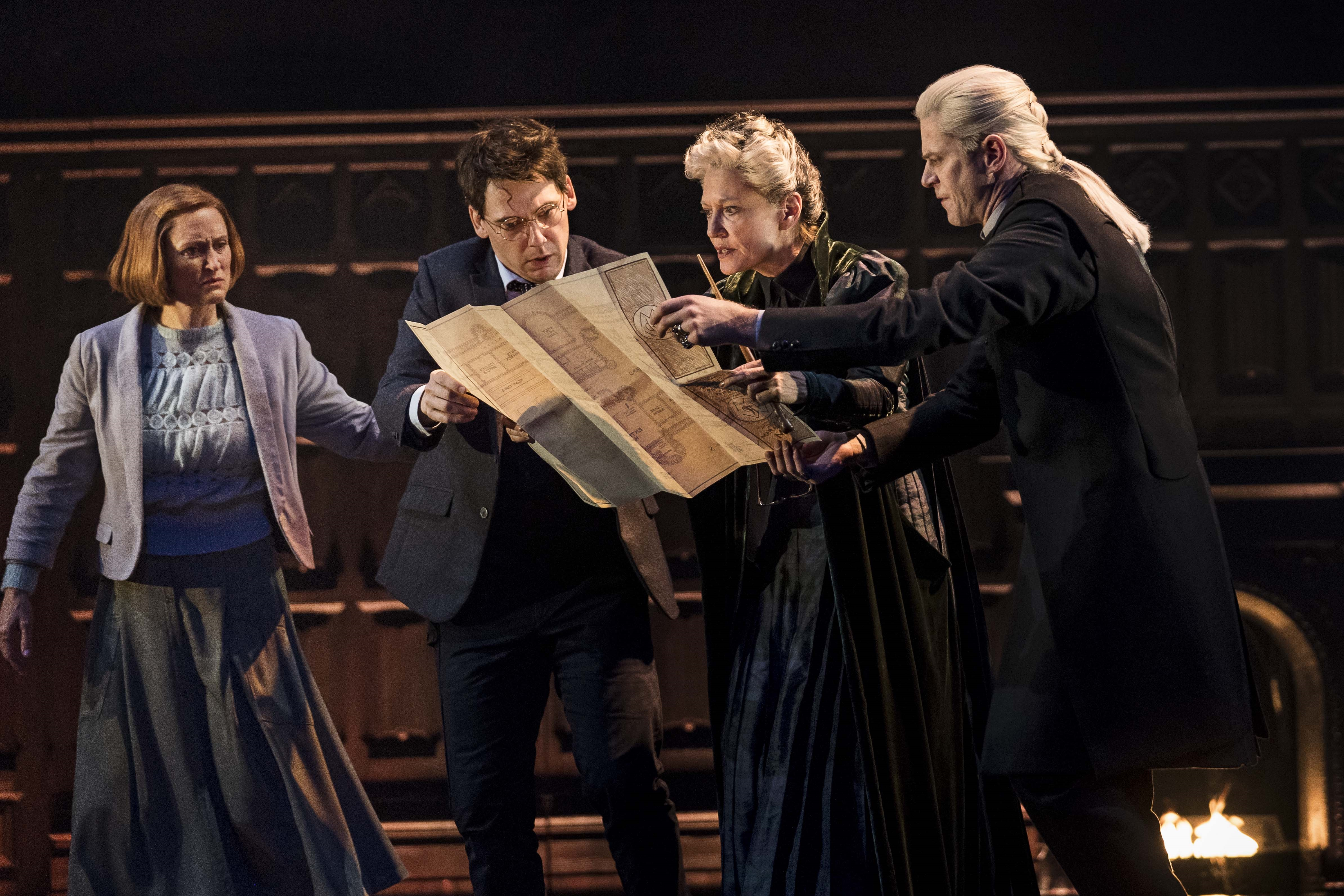 """Ginny, Harry, Professor McGonagall and Draco examine the Marauder's Map in a scene from """"Harry Potter and the Cursed Child"""" San Francisco."""