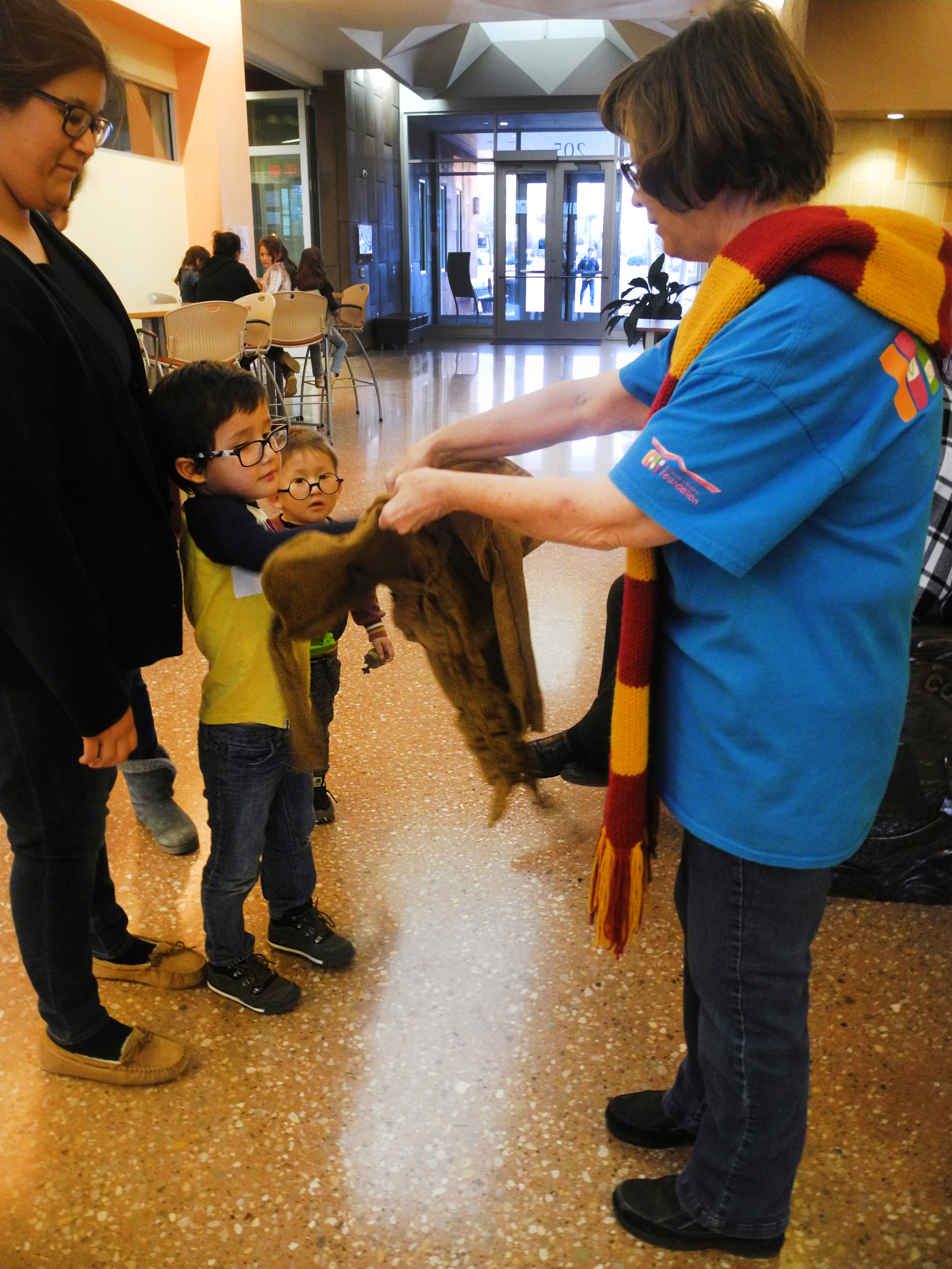 A boy chooses his Triwizard Tournament Champion character out of the Sorting Hat at a Harry Potter Book Night event.