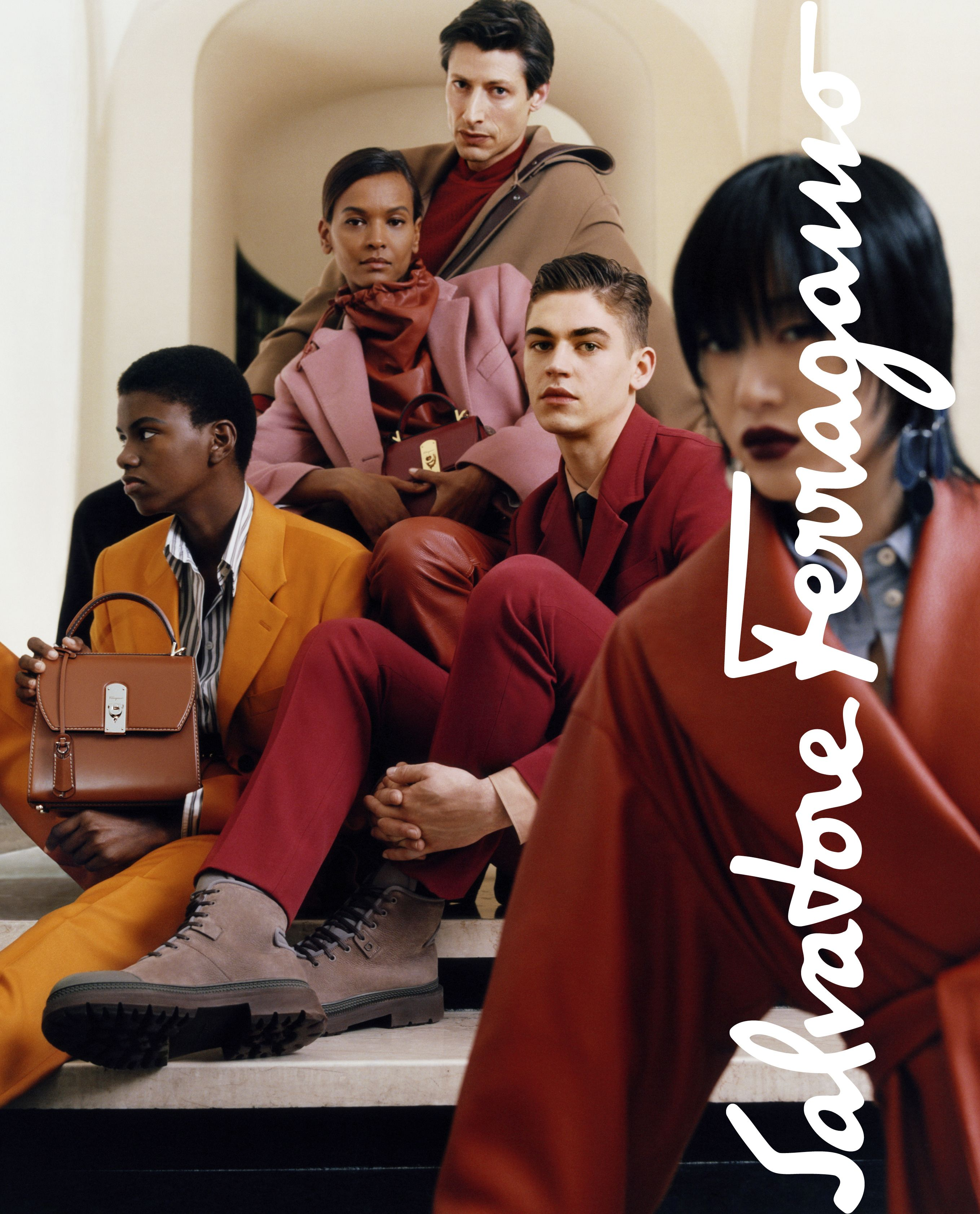Hero Fiennes-Tiffin still looks good even at parties where no one seems to be having any fun in this campaign photo for Salvatore Ferragamo.