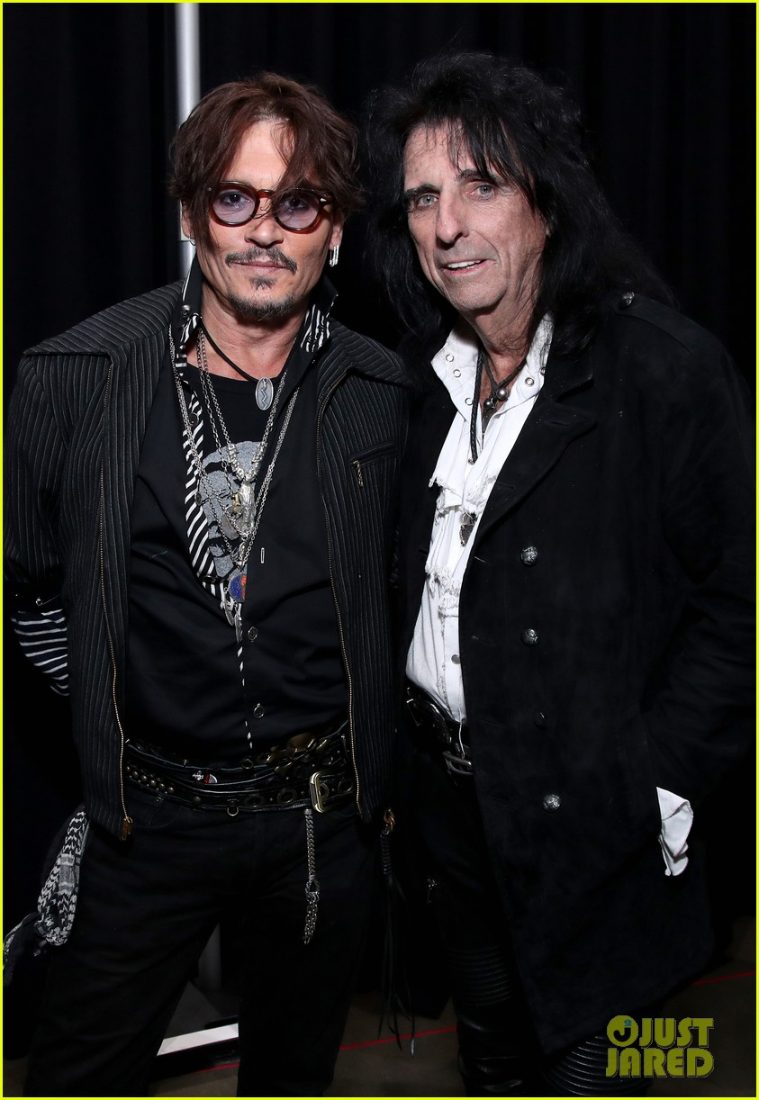Johnny Depp poses with Alice Cooper at Aerosmith's 50th anniversary celebration.