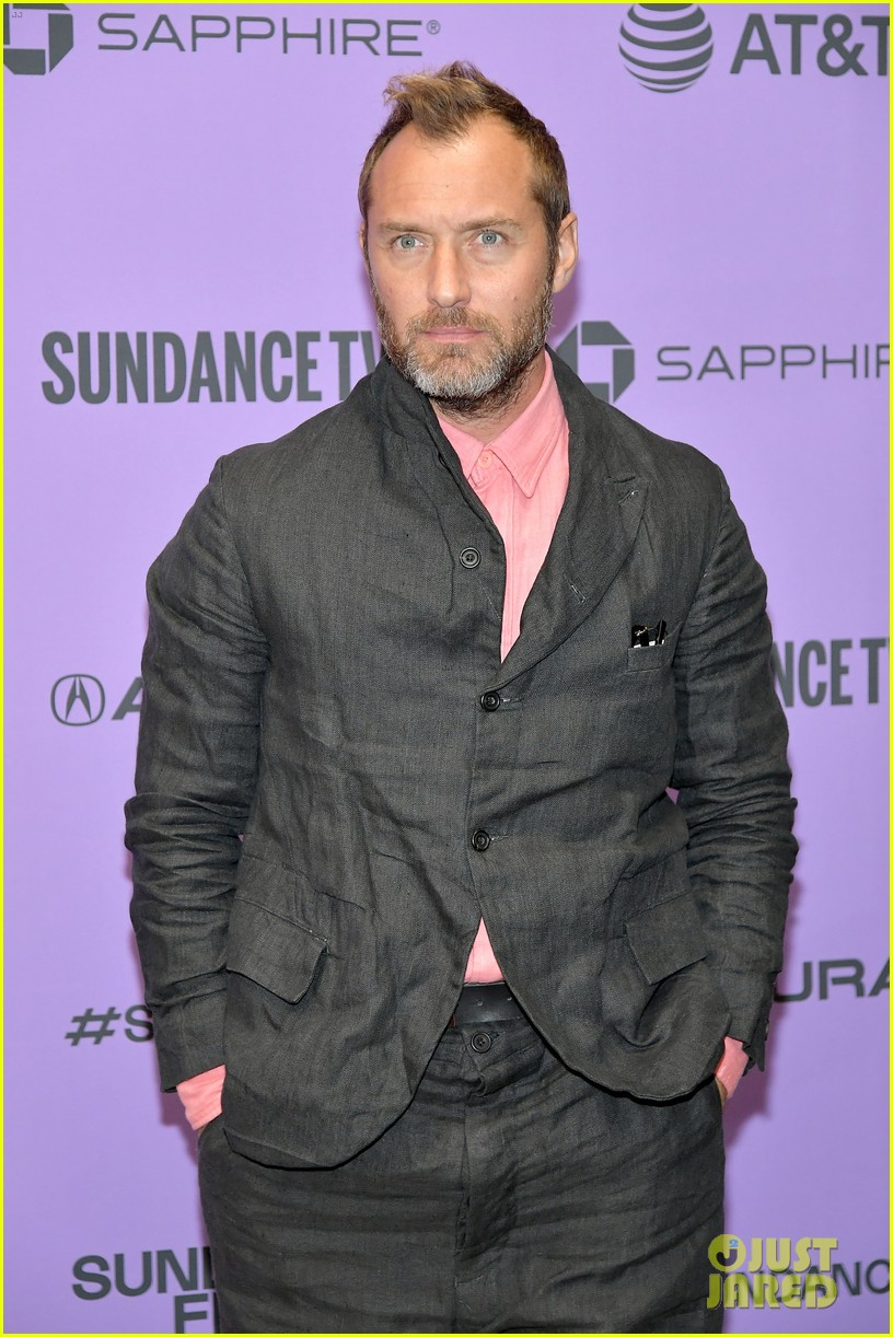 "Jude Law poses for photos during the premiere of his film ""The Nest"" at the Sundance Film Festival."