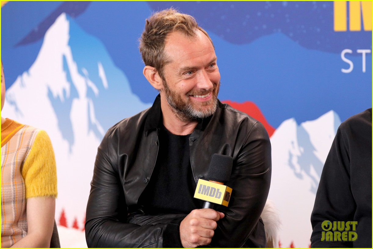 Jude Law laughs as he's interviewed by Kevin Smith at the Sundance Film Festival.