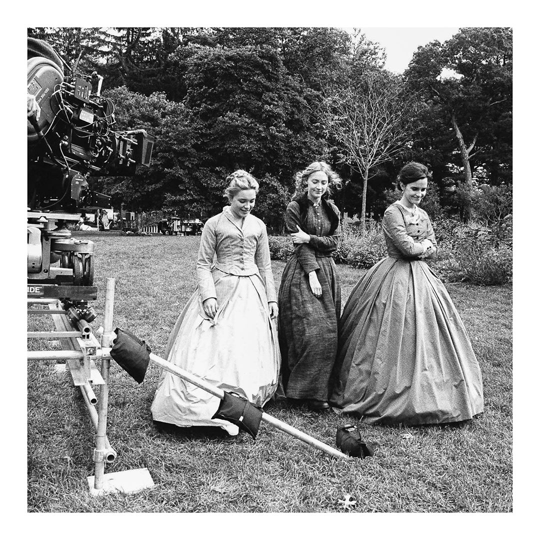 Florence Pugh, Saoirse Ronan, and Emma Watson on the set of Little Women