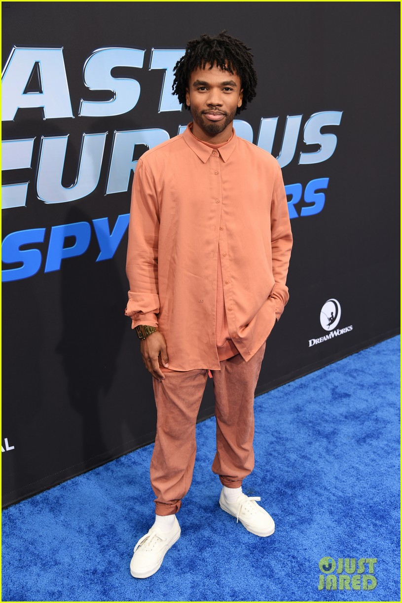 "Luke Youngblood poses on the red carpet at the premiere of ""Fast & Furious: Spy Racers""."