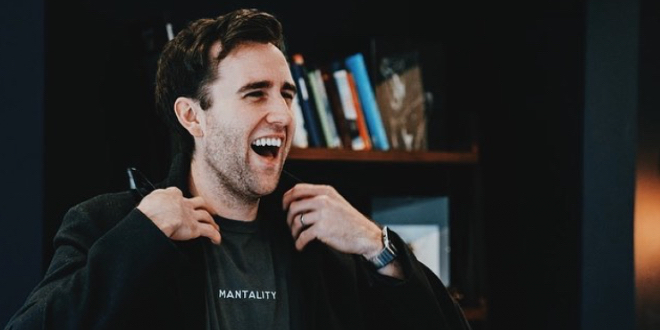Matthew Lewis is super smily and laughing.