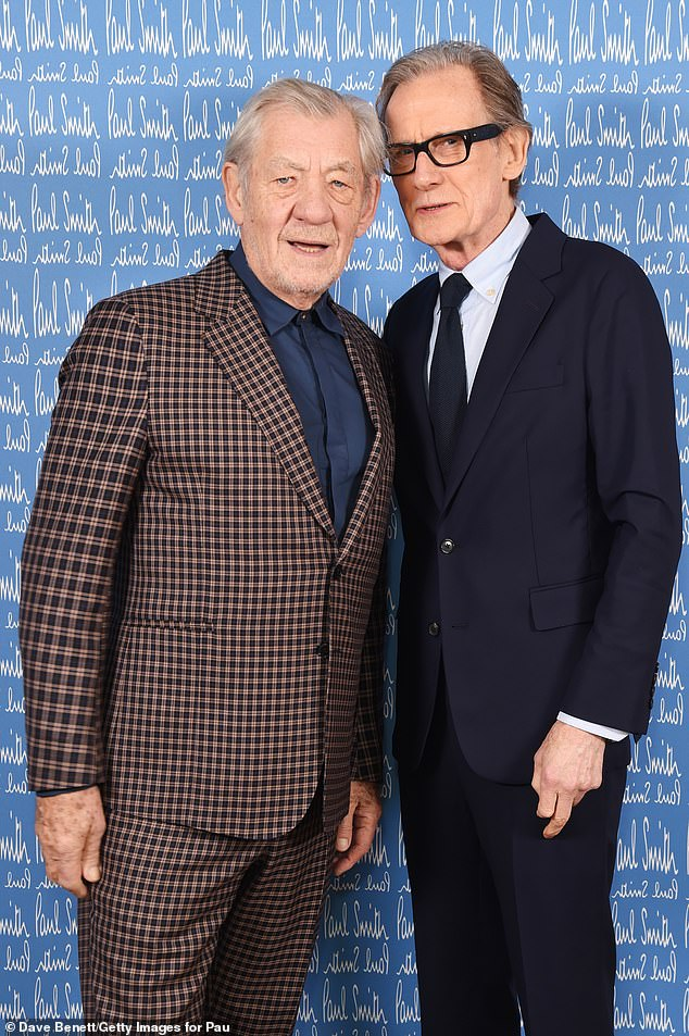 Bill Nighy poses with Sir Ian McKellen at Paul Smith's 50th anniversary show.