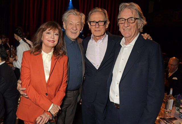 Bill Nighy poses with Sir Ian McKellen, Susan Sarandon, and Paul Smith at Smith's 50th anniversary show.