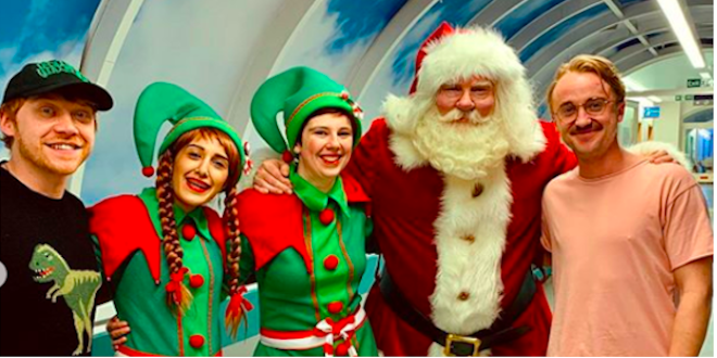 Rupert Grint and Tom Felton pay a festive visit to Great Ormond Street Hospital.