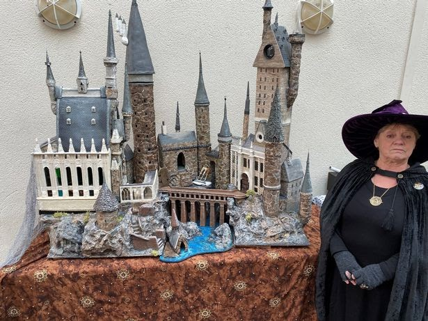 Clarke with her model of Hogwarts, which was constructed out of recycled materials.