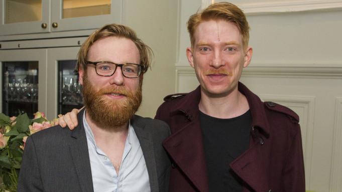 Domhnall Gleeson and brother Brian Gleeson pose for a photo.