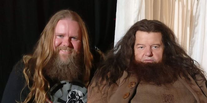 "Greg Draven (an actor and Hagrid body double) poses next to Robbie Coltrane, who played Hagrid in the ""Harry Potter"" movies."