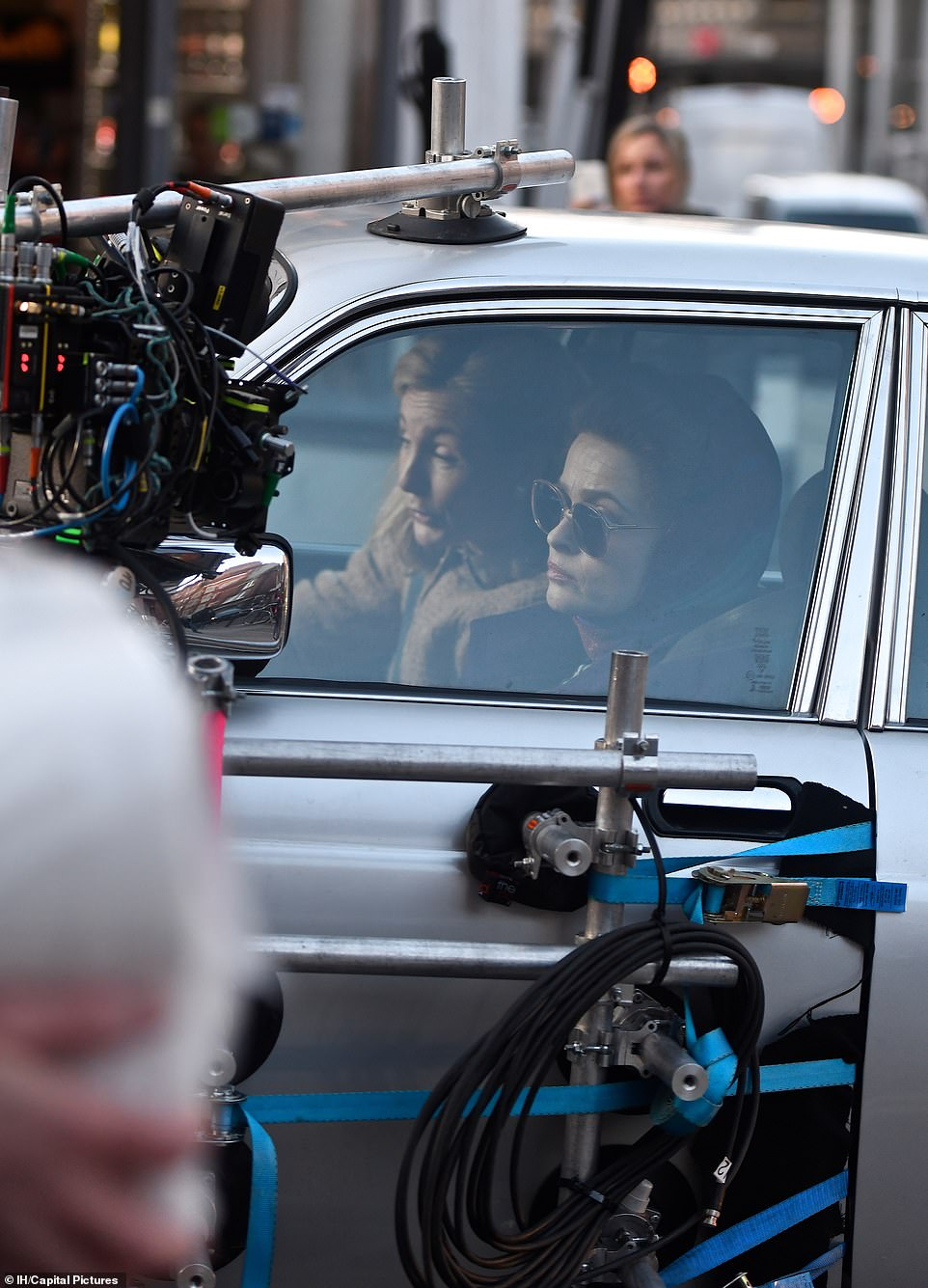 "Helena Bonham Carter is viewed through a car window during filming for Season 4 of ""The Crown""."
