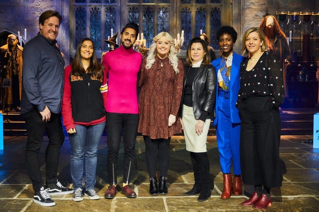 """The """"Making the Magic: From Story to Screen"""" panel poses for a photo at Warner Bros. Studio Tour London - The Making of Harry Potter."""