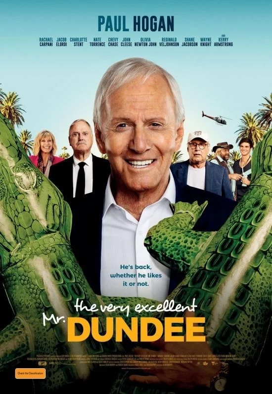 "John Cleese is seen on the movie poster for ""The Very Excellent Mr. Dundee""."