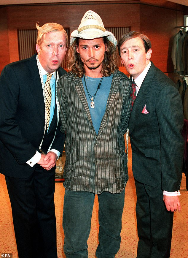 "Mark Williams, left, and Johnny Depp, center, are photographed after Depp appeared on ""The Fast Show""."