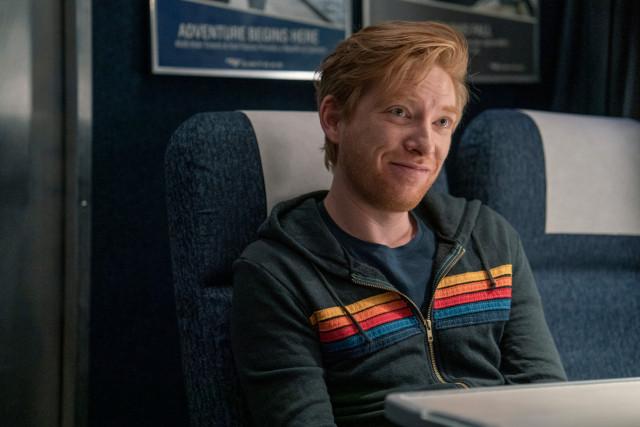"Domhnall Gleeson smiles during filming for HBO's ""Run""."