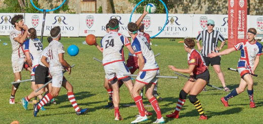 Pictured is a quidditch match between a UK team vs. a team in red-and-white jerseys.