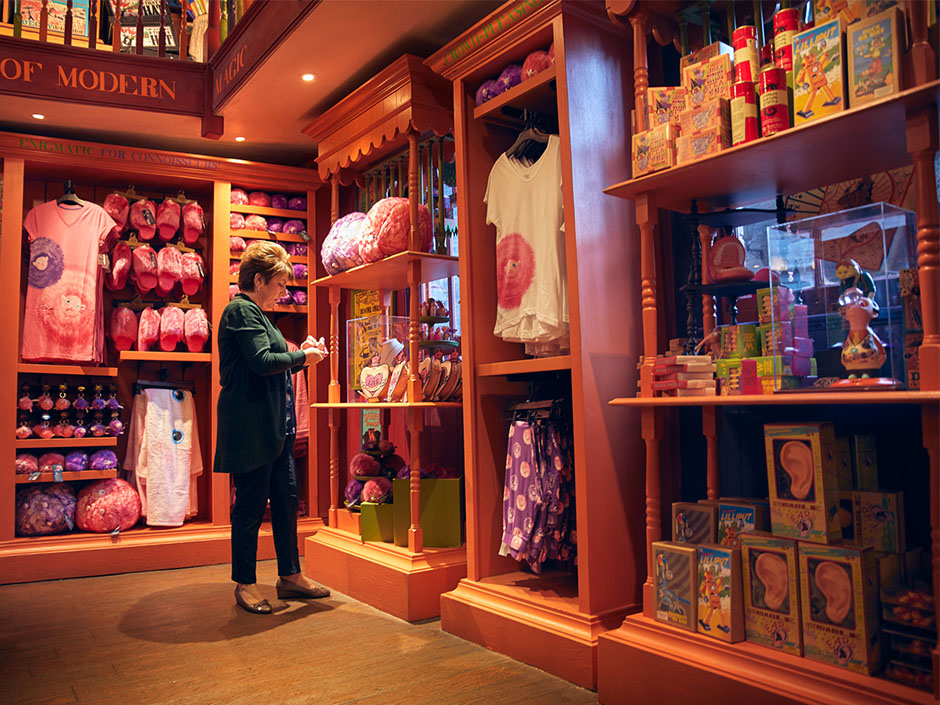 Senior buyer Maria Kazaros stands among her magical Weasleys' Wizard Wheezes merchandise.
