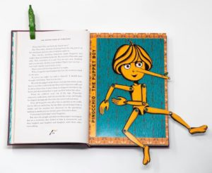 An interactive Pinocchio puppet in MinaLima's edition of the classic tale
