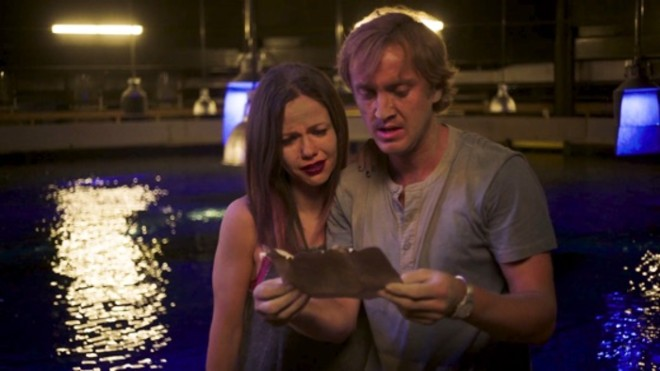 Tom Felton and onscreen sister played by Tammin Sursok are by a pool at night reading a letter. They are dishevelled and distraught.
