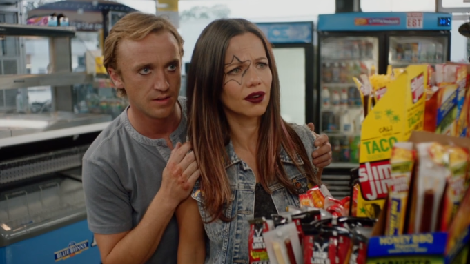 Tom Felton and Tammin Sursok play brother and sister in Braking for Whales. They are in a grocery store, lurking, Tom hiding behind her apprehensively.